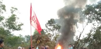 National road blockade with burning tire