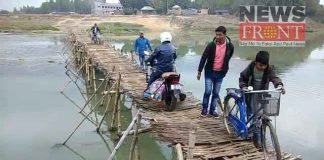 crossing the river by bamboo bridge