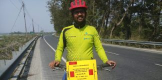 Country visit on cycle for protest mother tongue