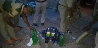 two arrested with wine
