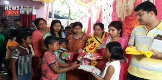 newly couple distribute food and clothes on marriage | newsfront.co